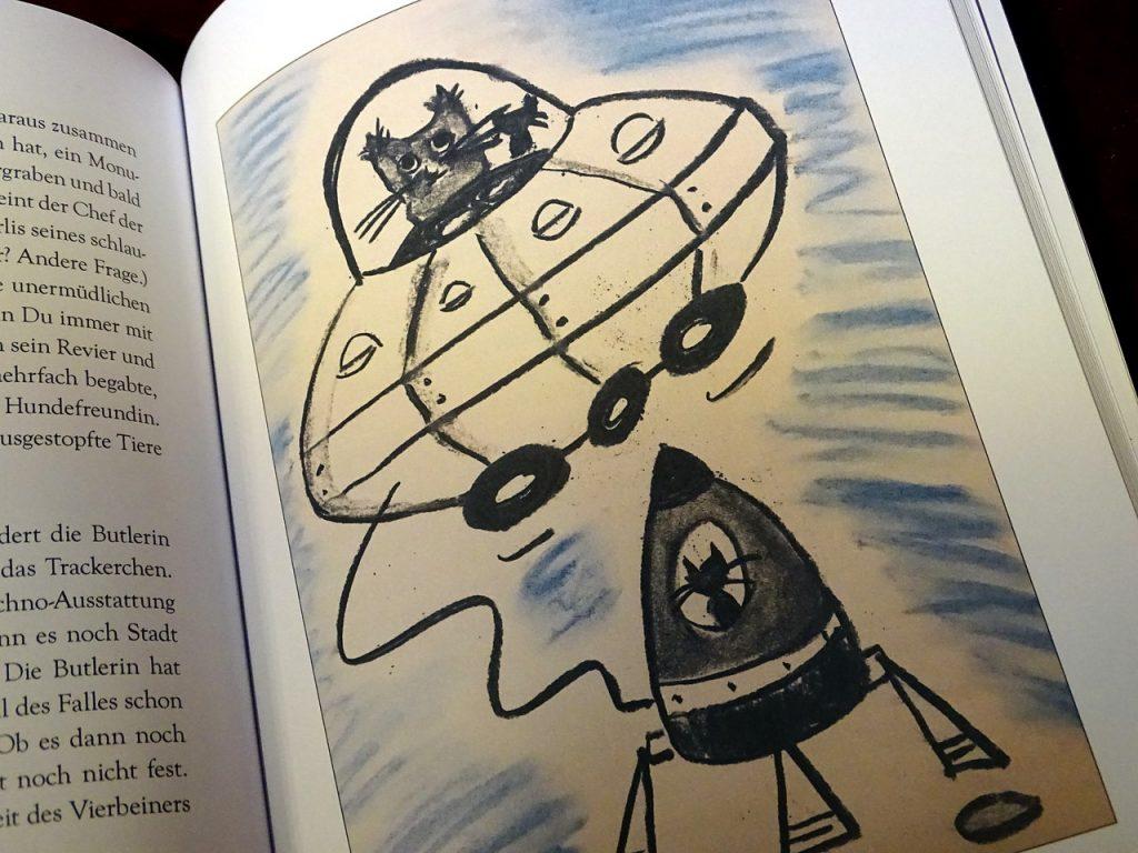 Graphik von Kater in einem Ufo mit einer anderen Katze, die in einer Raumkapsel sitzt
