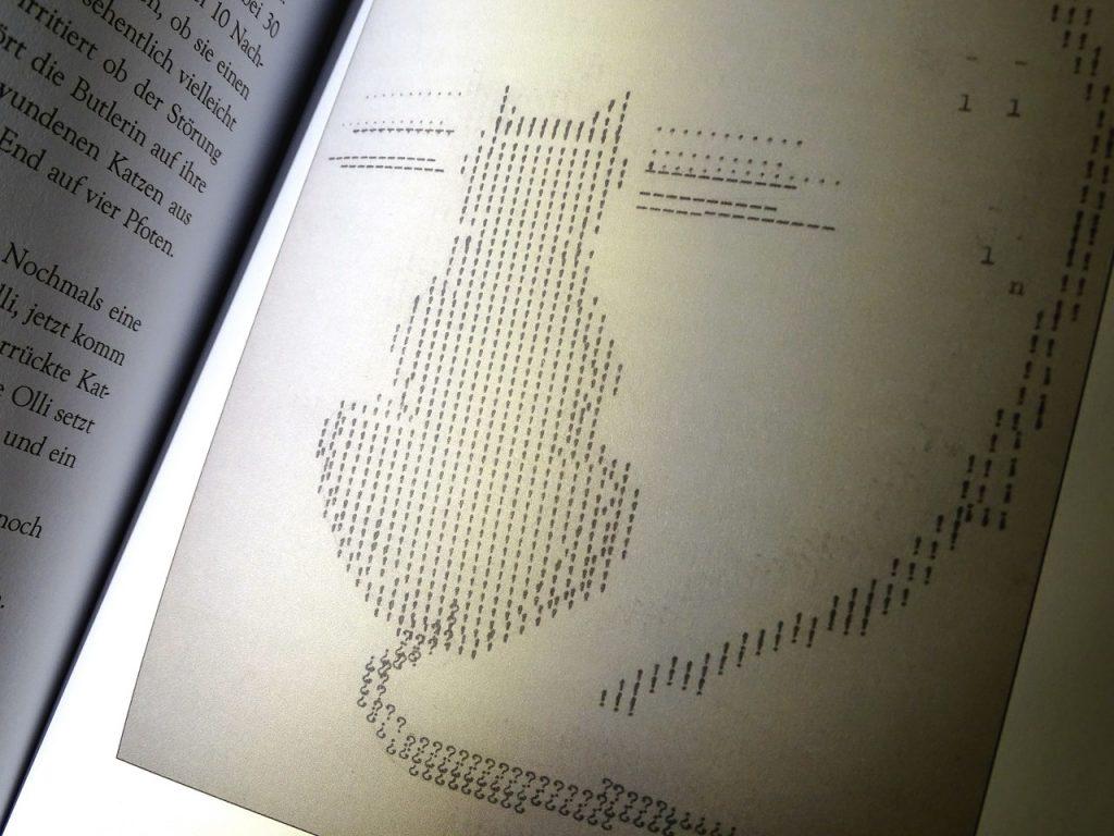 graphik von olli eine katze aus buchstaben
